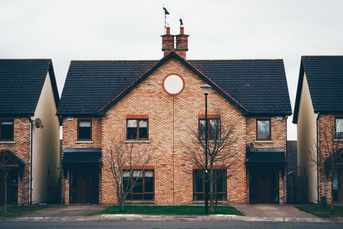 Red brick semi-detached house that is typical choice for a first owned home